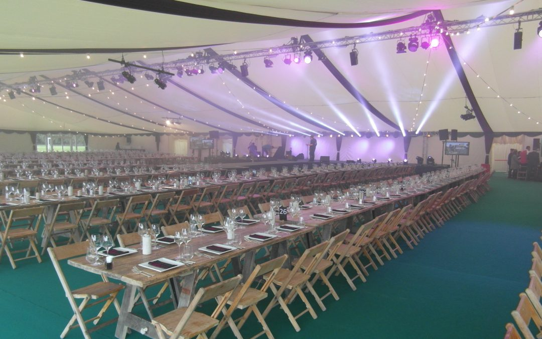 Purvis Marquees, corporate finishes, flat ivory linings, roof overlays, custom finishes, green carpet, rustic furniture, marquee lighting